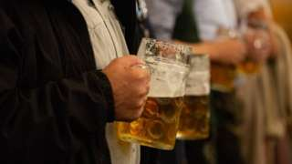 A man drinks beer at Oktoberfest