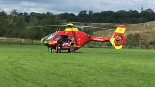 Air ambulance on football field