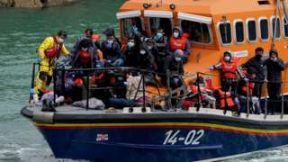 A group of people thought to be migrants are brought in to Dover onboard an RNLI boat following a small boat incident in the Channel