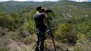 A police patrol surveys the border