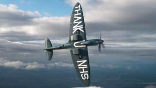 Spitfire with Thank you NHS message under wings