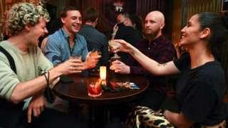 People celebrate in a bar in Melbourne