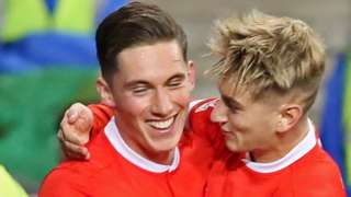 Harry Wilson celebrates scoring for Wales with David Brooks