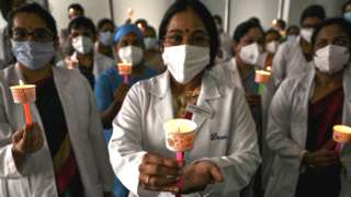 Doctors observe a candlelight vigil in tribute to doctors who lost their lives during the ongoing Covid-19 coronavirus pandemic on the occasion of National Doctors' Day, in Chennai on July 1,