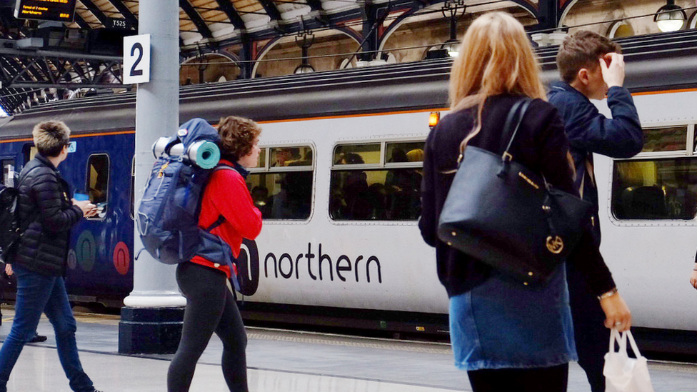 Passengers and a Northern train at Newcastle upon Tyne railway station