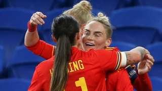 Wales' Jess Fishlock and Natasha Harding celebrate