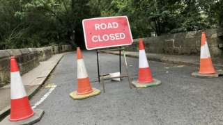 """Traffic cones and a """"Road closed"""" sign on Salters Bridge"""