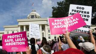 Protestors participate in a rally against one of the nation's most restrictive bans on abortions on May 19, 2019 in Montgomery, Alabama