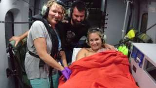 Midwife Linda, Alicia, Sandy and baby Torren on helicopter