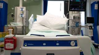 Empty intensive care bed