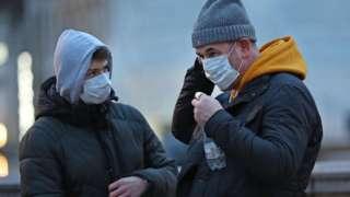 Men wearing face masks in central London