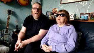 Judith Mason, 57, and her partner and carer Ron Roberts, 55, discuss her struggles at their Bootle home