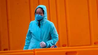 A woman in China wearing a facemask