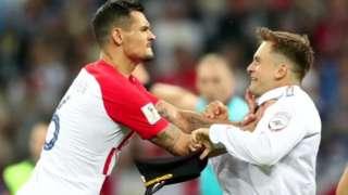 Croatia's Lovren grabbed pitch invader Pyotr Verzilov, 15 Jul 18