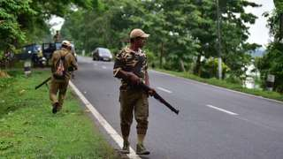 Forest officials stand guard in Nagaon district of Assam