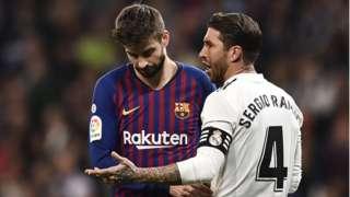 Barcelona centre-back Gerard Pique (left) dey follow Real Madrid counterpart Sergio Ramos (right) talk during an El Clasico match