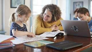 A parent home-schooling her children