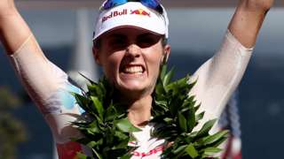 Lucy Charles celebrates finishing second in the Ironman World Championship