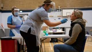 A nurse administers a test on Sarah Key at Dimensions Leisure Centre in Stoke-on-Trent during a testing session held by Stoke-on-Trent City Council using the newly-supplied lateral flow Covid-19 tests. PA Photo. Picture date: Friday November 13, 2020. The tests, which can provide a result within 20 minutes without any lab processing, are being rolled out nationally following earlier successful trials in both Stoke and Liverpool.