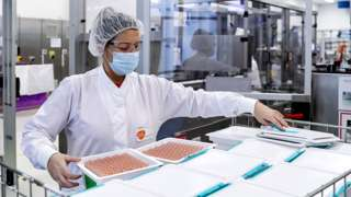 A GSK employee is at work at the factory of British pharmaceutical company GlaxoSmithKline (GSK) in Wavre, Belgium