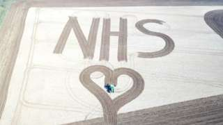 Giant NHS and heart ploughed into Glympton field