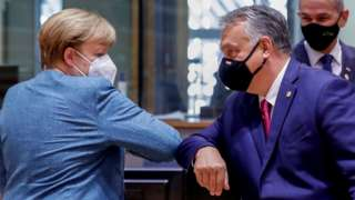"""German Chancellor Angela Merkel bumps elbows with Hungary""""s Prime Minister Viktor Orban at the start of the second face-to-face European Union summit since the coronavirus disease (COVID-19) outbreak, in Brussels, Belgium October 1, 2020"""