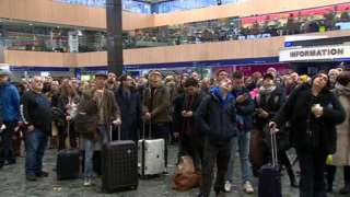 A crowd of passengers at London Euston