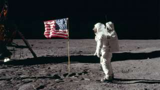 Buzz Aldrin salutes the US flag