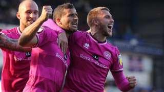 Toni Leistner, Tomer Hemed and Luke Freeman celebrate Hemed's goal against Ipswich