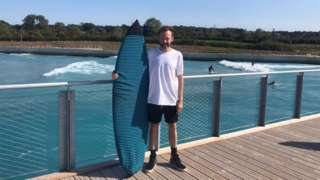 Jamie Monson with his surfboard