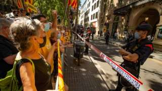 Pro-Catalan independence protesters gather outside the Liceu Theatre in Barcelona
