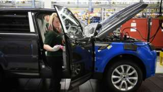Doors being fitted and checked during production at the Jaguar Land Rover plant in Solihull