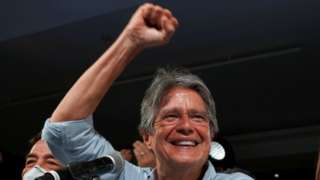 Ecuadorean banker Guillermo Lasso reacts after winning the presidential runoff vote, in Guayaquil, Ecuador April 11, 2021