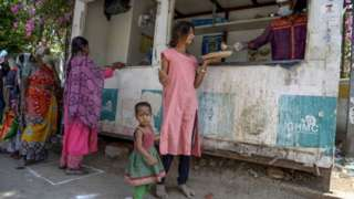 Homeless people receive free food offered by the Telangana state governement during a 21-day government-imposed nationwide lockdown as a preventive measure against the COVID-19 coronavirus in Hyderabad