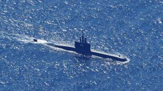 An aerial photo taken from a maritime patrol aircraft of 800 Air Squadron of the 2nd Air Wing of Naval Aviation Center (PUSPENERBAL), shows Indonesian Navy submarine KRI Alugoro sailing on a search mission for KRI Nanggala