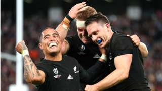 Ben Smith (R) of New Zealand celebrates with Sam Cane and Aaron Smith