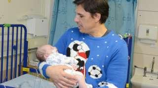 Sunderland manager Chris Coleman holds baby Logan Steel