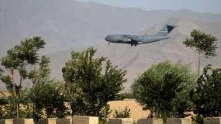 A US Air Force transport plane lands at the Bagram Air Base in Bagram on 1 July 2021
