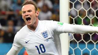 Wayne Rooney celebrates scoring for England