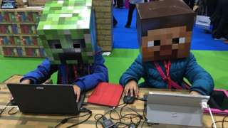 Kids on computers with Minecraft heads