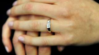 An engagement ring worn on a finger
