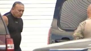 FBI officers escort Cesar Sayoc into an vehicle at FBI headquarters in Miramar, Florida, 26 October 2018