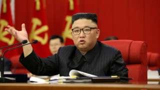North Korean leader Kim Jong Un speaks during a plenary meeting in June
