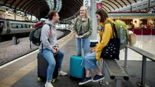 Students wait for train