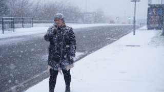 Woman walks through the snow in Thornaby