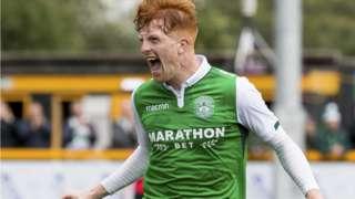 Simon Murray celebrates scoring one of his brace of goals