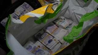 Cash in supermarket bag