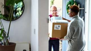 Woman receives Christmas delivery