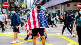 One Hong Kong protester is draped with the US flag during the 24th May 2020 protests.