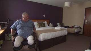 Mr Adams in hotel room